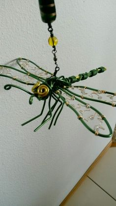 Wire wrapped beaded sun catcher,  dragonfly  with swivel so it can spin in the breeze.