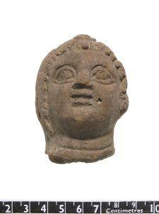 Head of terracotta figure of Eros.  BM