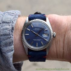 A 1972 Vintage Rolex Datejust Ref. 1603 Stainless Steel watch with a fluted bezel, an original blue dial with applied, luminous steel baton markers, and a 26-jewel, automatic caliber 1530 movement. This example also comes strapped with a Sueded Leather Blue-colored Watch Strap with Red Contrasting Stitching. (Store Inventory # 10289, listed at $3500, available for purchase online and in our store.) #rolex #datejust #blue #dial #calendar #classic #watch #vintage #watches #timepieces #stawc