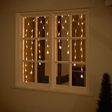 Our warm white star curtain lights will bring a wonderfully festive touch to your home this Christmas - they look especially great hanging in a window, displaying the bright stars running down each string! The 100 lights are static and mains operated with an overall curtain size of approx W  1.5m x H 1.35m<BR><BR>Suitable for indoor use only. The set also includes 1 spare fuse bulb and 4 spare standard bulbs. <BR><BR>Warning:<BR>Keep away from direct heat or flame.