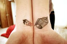 Having two wrists enables us to put two tattoos together to be one. We love this bird and open birdcage idea.