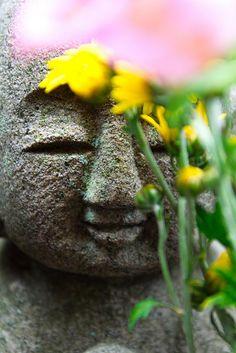 Kindly Smile of Jizo Stone Statue in Kamakura Hasedera Temple (Kanagawa, Japan)