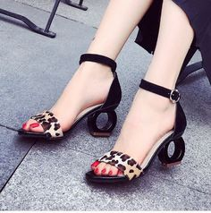 Complement your outfit with these unique high heel sandals. Features cover heel, ankle strap, open round shape heel. Crafted from PU and rubber material. This cute and wild pair sandal is perfect with
