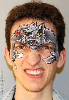 Great pirate cat face paint.  Good face painting idea for boys.