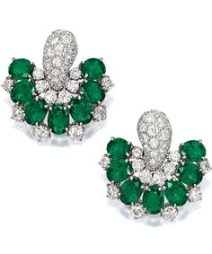 PAIR OF EMERALD AND DIAMOND EARCLIPS, BULGARI The earclips of inverted fan shape, each set with seven oval emeralds, decorated by brilliant-cut diamonds, the emeralds and diamonds altogether weighing approximately 13.50 and 6.30 carats, mounted in platinum, signed.