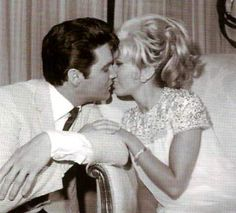 Elvis and actress Nancy Sinatra between scene in summer 1967 during the production of his movie Speedway.