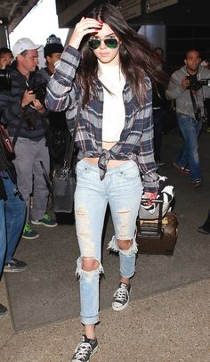 Kendall Jenner - Blue checked shirt, white crop top, distressed jeans, black Converse