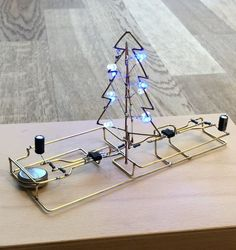 I've been getting into diy electronics and awhile ago I discovered Freeform (aka Flywire aka Deadbug) circuits and was immediately enamored. Recently Hackaday ran a Circuit sculpture contest, and there were some really great submissions, including. Electronics Basics, Electronics Components, Electronics Projects, Led Projects, Electrical Projects, Circuit Projects, Electronic Recycling, Electronic Art, Christmas Light Controller