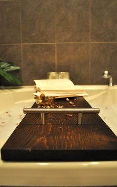 Easy DIY Bathtub Tray -  This DIY only cost $30 and it makes a huge statement in our bathroom.