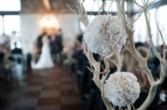It's always a great touch to have floral arrangements lining the aisle during the ceremony. Adds a beautiful ambiance and framing for the bride walking down the aisle