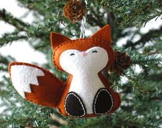 This listing is for an instant-download PDF-PATTERN. It is not a finished toy. This darling felt ornament is stitched entirely by hand, and is the perfect pattern for adventurous beginners. Finished ornament is approximately 4.5 inches tall. Skills required: - Basic embroidery skills - Blanket stitch - Back stitch - Stem stitch - Applique stitch This PDF pattern includes: - Materials list - Charming step by step instructions featuring original illustrations - Full-size pattern templates ...