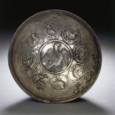A SASSANIAN SILVER BOWL circa 4th-6th century a.d. The rounded bowl decorated on the interior with a central medallion with an eagle facing right, its wings spread, the feathers with hatched chevrons and stippling, enclosed by eight smaller medallions each with different types of birds in various poses arranged in facing pairs, the rim off-set on the interior 6.13/16 in. (17.3 cm) in diameter Parthian Empire, Eagle Face, Romanesque Art, Sassanid, Achaemenid, Classical Period, Ancient Persian, Ancient Near East, Persian Culture