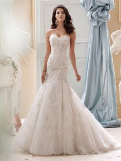 David Tutera for Mon Cheri style 115232 is one of the beautiful blue wedding dresses in his collection of bridal gowns. Click for details on this style.