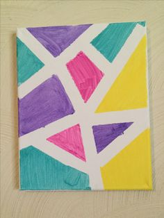Aztec Canvas! you will need paint, tape, and a canvas. 1. make shapes on the canvas with the tape. 2. paint inside the shapes. 3. let dry and peel off! 4. enjoy!