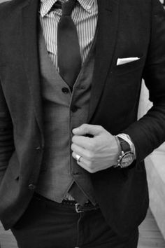 Even in black and white this suit looks amazing. From the crisp, clean lines of the apparel, to the smooth accent of the accessories this is a damn good combination. The watch stands out to me as a very significant piece.