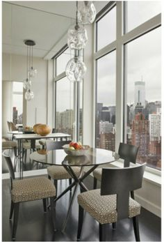 Located in the Upper East Side, Champeau & Wilde were inspired by the striking New York City views that are visible from each room of the penthouse. Dining Area, Dining Table, Dining Rooms, Apartment View, Interior Design Elements, Under The Table, Upper East Side, Reception Rooms, Pent House