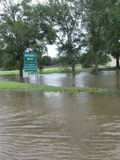 Flooding in front of the town sign, New Iberia, Louisiana; results of Hurricane Gustav.