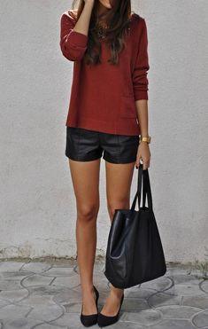 Red sweater, leather shorts, black pumps, and a black tote.