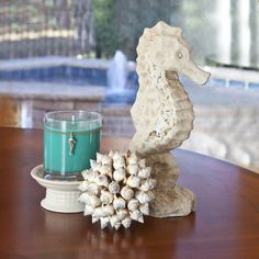 Ceramic Seahorse Scented Candle Centerpiece - If you are a lover of the sea then the combination of this cute cement seahorse figurine, shell ball and teal candle are the ultimate ocean themed candle gift.