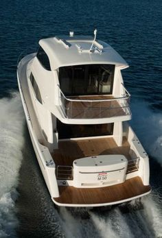 The Maritimo M50's cockpit, large open deck abaft the enclosed bridge, and walk-around side decks are well suited to outdoor living, not just fishing.
