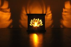 The Lotus Flower Tea Light Holder The lotus flower represents purity, beauty, spiritual awakening, and enlightenment. It also symbolizes rebirth and the sun. The lotus is in tune with the heart and crown chakras. A ONE-OF-A-KIND GIFT WITH MEANING, READY TO GIVE! This beautiful birch wood LOTUS FLOWER tea light holder comes fully assembled and complete with its own LED faux candle, ready to display. We laser cut the unique design, and hand assemble them in our workshop based in Tampa…