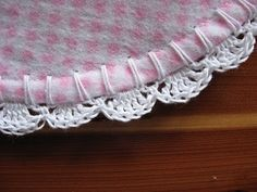 Create a beautiful crocheted shell edging on receiving blankets for your baby or as a gift, using our free pattern from Craftown.