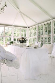 sunroom with walls of windows.. Old window styling