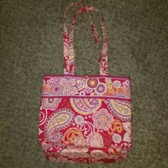 Vera Bradley pink tote purse bag Vera Bradley pink tote purse bag.  In good condition. Dimensions are as follows Strap to purse 12 inches Strap to bottom of purse 25 inches Inside length 13 1/2 inches Inside width 11 inches.   This does not zip, it has a button with a cloth hook. 1 hanging pocket inside. None on the outside. Thank you for shopping my closet. :) lmk if you have any questions. Vera Bradley Bags Shoulder Bags