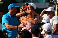 Maria Sharapova - 2014 French Open - Day Fourteen. Maria Sharapova of Russia celebrates with her team following her victory in her women's singles final match against Simona Halep of Romania on day fourteen of the French Open at Roland Garros on June 7, 2014 in Paris, France.