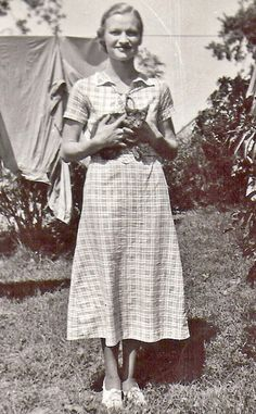 1930s daytime dress: dresses were shorter and usually kind of plain. less luxurious fabrics were used because it was all anyone could afford because of the war