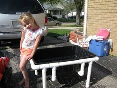 """DIY Sand box - Twenty feet of 1.5 inch PVC, some """"elbows"""", some """"tees"""", some PVC glue, a concrete mixing tub, and some sand are all we needed."""