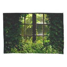 A cottage garden window overgrown with plants pillowcase