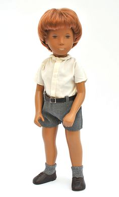 "15"" very early redhead Gregor doll wearing Shorts outfit, made only at the beginning of the English production period, with dark tan skin, brown eyes and oxidized lip paint that has turned a faint off-white color, wearing original schoolboy fashion with very rare brown leather laced shoes with heel, one of the first Sasha dolls released under the English production, United Kingdom, 1968, by Frido (later incorporated as Trendon Toys)."