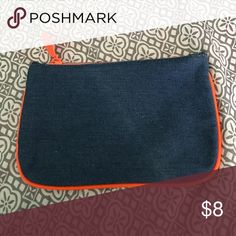 Ipsy February 2017 makeup bag Its a denim type of fabric on the outside lines with orange tubing Other