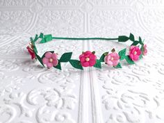 Find this piece here: https://www.etsy.com/listing/222429558/the-pink-flora-crown