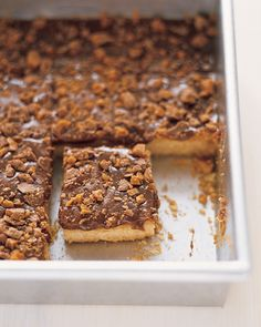 Take our Classic Shortbread to the next level by covering it in melted chocolate-toffee bars and sprinkling shards of candy on top.