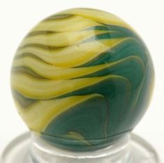 """Christensen Agate Tri-Color Flame Marble Price Realized $360 Light yellow base with mint green and olive green flame tips. Great flame pattern to this marble. Condition (9.6). Size 21/32"""" Dia."""