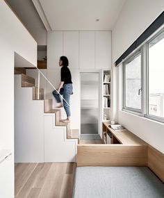 Taiwanese studio A Little Design has converted a former piano studio in Taipei, Taiwan into a tiny apartment with built-in, space-saving furniture. Japanese Apartment, Apartment Entryway, Apartment Furniture, White Apartment, Minimalist Apartment, Apartment Layout, Apartment Interior, Apartment Living, Apartment Ideas