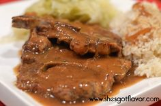 BRAISED PORK CHOPS, GARLIC BUTTER RICE AND CABBAGE | She's Got Flavor