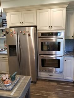 Side by side refrigerator  and dual ovens saved more space in my kitchen for additional  open shelving and cabinets.