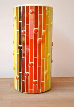 Glass mosaic vase. I'd use different colors to match my decor, but l like the pattern.