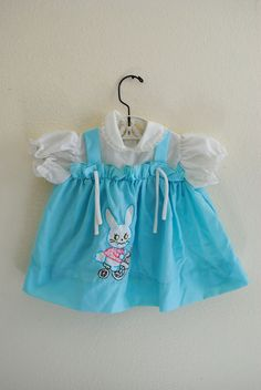 vintage girl blue bunny dress