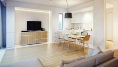 A custom wall lets the television and media storage sit completely out of the way without using heavy furniture.