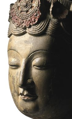 An extremely rare large limestone head of a bodhisattva, Sui dynasty