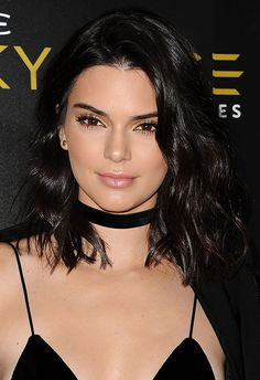Tousled curls are one of Kendall's fave looks. On this occasion, she ups the fancy for night-time by making them a little tighter and glossier (heaven). Create more structured curls like these using a conical wand and spritz on some high-shine spray to get the same full finish