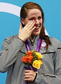 Missy Franklin–USA–Swimming Missy Franklin of the U.S. overwhelmed with emotion displays her red, white and blue flag nails. She wipes her eyes as she poses with her gold medal after winning the women's 100m backstroke final at the London 2012 Olympic Games at the Aquatics Centre July 30, 2012.