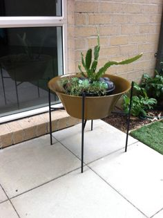 Vintage 1950s metal planter on Kurrlson iron rod stand in the style of Architectural Pottery
