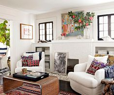 Love the neutral background with all the pops of color! More fireplace decor ideas: http://www.bhg.com/decorating/fireplace/styles/find-your-perfect-fireplace/