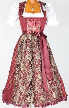 Regally, richly beautiful shades of plum and dark champagne. German dirndl folk dress.