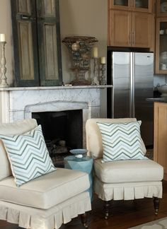 """""""After"""" - a few small changes on the  mantel and the addition of jazzy pillows  and a vibrant garden table."""